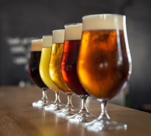 How to drink beer like a pro? Photograph of five tulip shaped glasses filled with different coloured beer