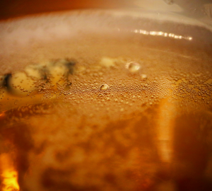 How to drink beer like a pro? Close up photograph  of bubbles inside of a beer glass