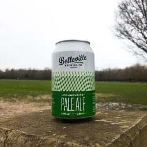 Deep Dive Into Commonside Pale Ale. Photograph of a can of Comonside Pale Ale with a grassy Wandsworth Common in the background.
