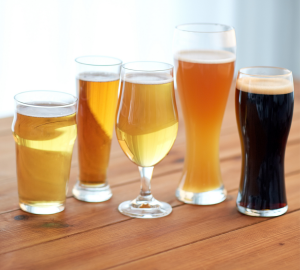 How to drink beer like a pro? Photograph of different styles of beer glass including a pint, weizen and tulip shaped glass