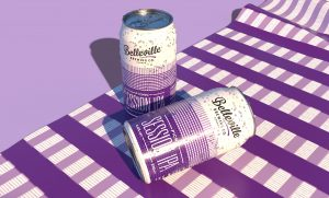 Deep Dive into Picnic Session IPA. Vector image of two purple cans of Picnic Session IPA laid out on a purple, checkered pattern picnic blanket.